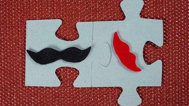 男女をかたどったパズルのピース